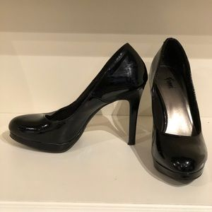 Fioni black rounded toe high heel pumps.
